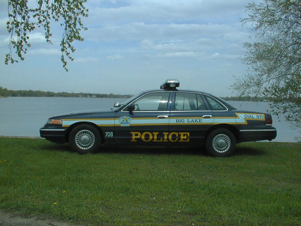 Police Car by a Lake